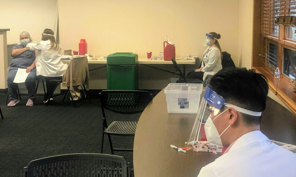 Medical providers at vaccination clinic